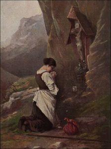 Mulher rezando a Jesus